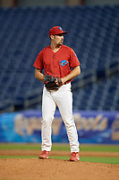 Clearwater Threshers relief pitcher Blake Quinn (55) gets ready to deliver a pitch during a game against the Dunedin Blue Jays on April 6, 2018 at Spectrum Field in Clearwater, Florida.  Clearwater defeated Dunedin 8-0.  (Mike Janes/Four Seam Images)