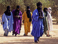 Akadaney, Central Niger, West Africa.  Fulani Nomads, Men Walking, Mouths Veiled in Tuareg Fashion.  Annual Gathering, Geerewol.