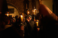 Girls wearing cloaks prepare to march in a Good Friday religious procession in Lessines, Belgium on March, 29 2013. The procession has taken place for more than five centuries and includes many marchers wearing executioners hoods and carrying torches.