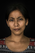 31 year old fisherwoman, Melialin Tupal poses for a portrait at the Casa, the Tuna buying house in Puerto Princesa, Palawan in the Philippines. <br /> Photo: Sanjit Das/Panos for Greenpeace