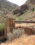 An old adobe covered rock building at the mouth of the canyon along the Colorado River in western Colorado.