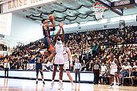 WASHINGTON, DC - NOVEMBER 16: Troy Baxter #13 of Morgan State shoots high over Maceo Jack #14 of George Washington during a game between Morgan State University and George Washington University at The Smith Center on November 16, 2019 in Washington, DC.