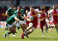 24th April 2021; Brentford Community Stadium, London, England; Gallagher Premiership Rugby, London Irish versus Harlequins; Alex Dombrandt of Harlequins tackled Curtis Rona of London Irish