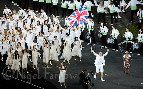 27 JUL 2012 - LONDON, GBR - Cyclist Sir Chris Hoy (GBR) leads the Great Britain team around the Olympic Stadium during the Opening Ceremony of the London 2012 Olympic Games in Stratford, London, Great Britain (PHOTO (C) 2012 NIGEL FARROW)