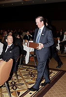 """Lawrence Cannon , Minister of Transport, Infrastructure and Communities, Quebec<br /> watch Tony Comper, President and Chief<br /> Executive Officer of BMO Financial Group and co-founder of FAST (Fighting Antisemitism Together), walk back with a gift afer he  address the Canadian Club of Montreal on  """"Why non-Jews must confront antisemitism"""", September 11 2006.<br /> Photo by Pierre Roussel / Images Distribution"""