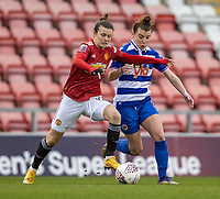 7th February 2021; Leigh Sports Village, Lancashire, England; Women's English Super League, Manchester United Women versus Reading Women; Hayley Ladd of Manchester United Women is tackled by Angharas James of Reading