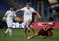 Calcio, Serie A: Roma vs Milan. Roma, stadio Olimpico, 12 dicembre 2016.<br /> Milan's Ignazio Abate, left, is challenged by Roma's Emerson Palmieri during the Italian Serie A football match between Roma and AC Milan at Rome's Olympic stadium, 12 December 2016.<br /> UPDATE IMAGES PRESS/Isabella Bonotto