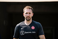 CARY, NC - SEPTEMBER 12: Portland Thorns assistant coach Rich Gunney exits the tunnel for warm-ups before a game between Portland Thorns FC and North Carolina Courage at WakeMed Soccer Park on September 12, 2021 in Cary, North Carolina.