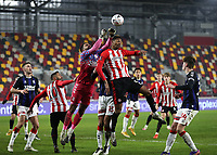 9th January 2021; Brentford Community Stadium, London, England; English FA Cup Football, Brentford FC versus Middlesbrough; Goalkeeper Jordan Archer of Middlesbrough punches the ball above Ethan Pinnock of Brentford to clear his box