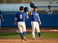 IMG Academy Ascenders Jack Thompson (6) celebrates with James Scott (9) after hitting a home run during a game against the Montverde Academy Eagles on April 8, 2021 at IMG Academy in Bradenton, Florida.  (Mike Janes/Four Seam Images)