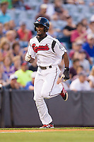 Eugenio Velez (4) of the Nashville Sounds hustles towards home plate against the Oklahoma City RedHawks at Greer Stadium on July 25, 2014 in Nashville, Tennessee.  The Sounds defeated the RedHawks 2-0.  (Brian Westerholt/Four Seam Images)