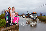 Yvonne, Rebecca and Karen O'Connell watching cars and trucks attempting to drive through the floods outside their home in Ballymalis on the Beaufort to Killorglin road on Tuesday morning