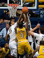 Richard Solomon of California blocks CSUB's Justin Omogun's shot during the game against CSUB at Haas Pavilion in Berkeley, California on November 11th, 2012.  California defeated CSUB, 78-65.