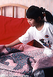 6 year old girl at home in bedroom chores making own bed vertical