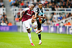 Angelo Ogbonna of West Ham and Callum Wilson of Newcastle contest a loose ball. Newcastle v West Ham, August 15th 2021. The first game of the season, and the first time fans were allowed into St James Park since the Coronavirus pandemic. 50,673 people watched West Ham come from behind twice to secure a 2-4 win.