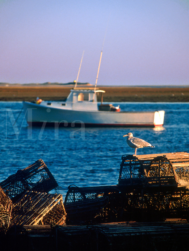 Wooden lobster traps and lobster boat.