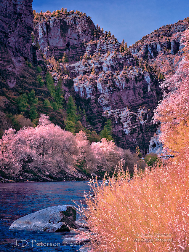 Glenwood Canyon, Colorado (Infrared) ©2017 James D Peterson.  The Colorado River has cut this remarkable passage through the Rockies in the western part of the state.  It serves as the route for a transcontinental railroad, kayakers (look carefully), and Interstate 70 (a small stretch of which can be seen in the distance).