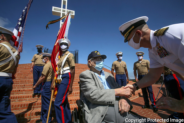Honoree, retired Marine Corps Col. Dave Severance, age 101, seated center, talks with Brig. Gen. Ryan Heritage, right, during a recognition ceremony for Severance at Mt. Soledad Veterans Memorial Saturday, 07/25/20. Colonel Severance retired from the Marine Corps in 1968 with 32 years of service, leading Marines in combat on Iwo Jima in World War II and flying nearly 70 missions in Korea as an aviator. photo by Bill Wechter