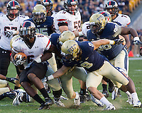 Gardner-Webb running back Kenny Little (6)  avoids tackles from Ray Vinopal (9) and LaQuentin Smith (98). The Pitt Panthers defeated the Gardner-Webb Runnin Bulldogs 55-10 at Heinz Field, Pittsburgh PA on September 22, 2012..