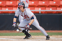 Cory Harrilchak #4 of the Rome Braves lays down a bunt against the Hickory Crawdads at  L.P. Frans Stadium May 23, 2010, in Hickory, North Carolina.  The Rome Braves defeated the Hickory Crawdads 5-1.  Photo by Brian Westerholt / Four Seam Images