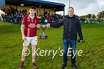 Cromane captain accepts the 2020 Novice Club football Championship cup from Eamon Whelan, Vice Chairman of the Kerry County Committee after win over over Asdee.