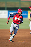 Osvaldo Abreu (10) of the Hagerstown Suns hustles towards third base against the Kannapolis Intimidators at CMC-Northeast Stadium on June 16, 2015 in Kannapolis, North Carolina.  The Suns defeated the Intimidators 8-4.  (Brian Westerholt/Four Seam Images)