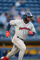 Pawtucket Red Sox center fielder Rusney Castillo (38) runs to first base during a game against the Scranton/Wilkes-Barre RailRiders on May 15, 2017 at PNC Field in Moosic, Pennsylvania.  Scranton defeated Pawtucket 8-4.  (Mike Janes/Four Seam Images)