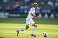 CARSON, CA - MAY 8: Julian Araujo #2 of the Los Angeles Galaxy moves with the ball during a game between Los Angeles FC and Los Angeles Galaxy at Dignity Health Sports Park on May 8, 2021 in Carson, California.