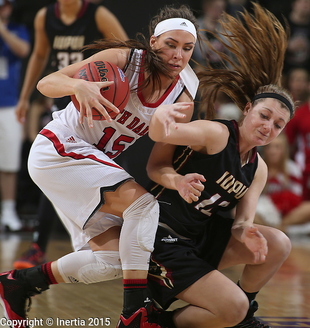 SIOUX FALLS, SD - MARCH 9: Caitlyn Tolen #12 of IUPUI and Kelly Steward #15 of USD battle for the ball in the second half of their semi-final round Summit League Championship Tournament game Monday afternoon at the Denny Sanford Premier Center in Sioux Falls, SD. (Photo by Richard Carlson/Inertia)