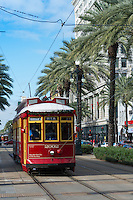 Red trolley car on Canal Street in downtown New Orleans, Louisiana