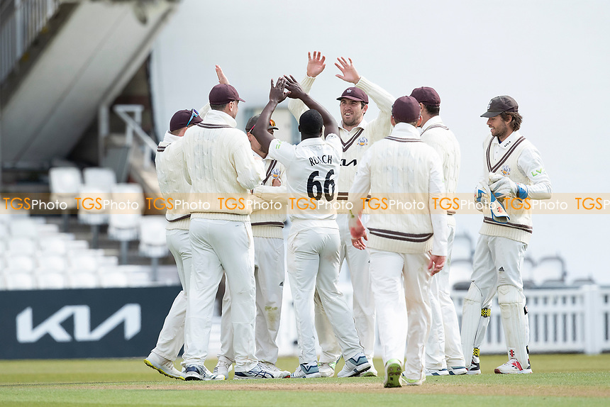 Surrey players celebrate with Kemar Roach following his fifth wicket during Surrey CCC vs Hampshire CCC, LV Insurance County Championship Group 2 Cricket at the Kia Oval on 1st May 2021