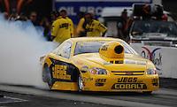 Oct. 31, 2008; Las Vegas, NV, USA: NHRA pro stock driver Jeg Coughlin Jr does a burnout during qualifying for the Las Vegas Nationals at The Strip in Las Vegas. Mandatory Credit: Mark J. Rebilas-
