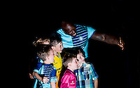 New Signing Adebayo Akinfenwa poses with young supporters  during the Wycombe Wanderers 2016/17 Kit launch to the Public at Adams Park, High Wycombe, England on 10 July 2016. Photo by Andy Rowland.