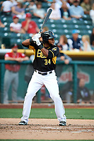 Cesar Puello (34) of the Salt Lake Bees bats against the Albuquerque Isotopes in Pacific Coast League action at Smith's Ballpark on June 10, 2017 in Salt Lake City, Utah. The Isotopes defeated the Bees 4-2. (Stephen Smith/Four Seam Images)