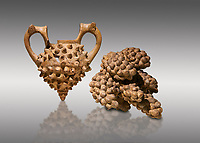 Hittite terra cotta two handled vessel and a ritual vessel in the shape of a bunch of grapes - 16th century BC - Hattusa ( Bogazkoy ) - Museum of Anatolian Civilisations, Ankara, Turkey . Against gray background