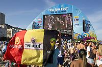 Belgium fans with a flag watch the big screen at the FIFA Fan Fest on Copacabana beach in Rio de Janeiro