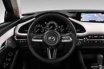 Car pictures of steering wheel view of a 2020 Mazda Mazda3 Skycruise 4 Door Sedan Steering Wheel