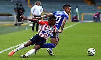 BOGOTA - COLOMBIA, 13-06-2021: Cristian Arango de Millonarios F. C. y Fabian Viafara de Atletico Junior disputan el balon durante partido entre Millonarios F. C. y Atletico Junior de vuelta de las Semifinales por la Liga BetPlay DIMAYOR I 2021 jugado en el estadio Nemesio Camacho El Campin de la ciudad de Bogota. / Cristian Arango of Millonarios F. C. and Fabian Viafara of Atletico Junior figth for the ball during a match between Millonarios F. C. and Atletico Junior of the second leg of the Semifinals for the BetPlay DIMAYOR I 2021 League played at the Nemesio Camacho El Campin Stadium in Bogota city. / Photo: VizzorImage / Daniel Garzon / Cont.