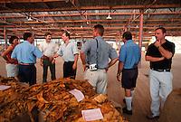 Last Sale - The Buyers (l to r) Vinka Prizmic, Joe Miott (PM), Rob Edgley and Phil Hando (BATA), Bodyguard, Vince Giacometti and Rob (BATA), Mareeba Sales Floor, Mareeba, 2004.