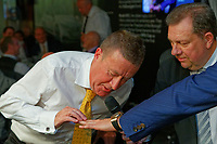 Pictured: A member of the public checks whether the coin shows heads or tails with Kev Johns (R). Wednesday 02 May 2018<br /> Re: Swansea City AFC Official Player Of The Season Awards Dinner 2018 at the Liberty Stadium, Wales, UK.