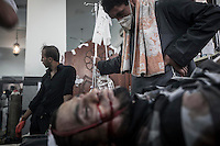 In this Wednesday, Aug. 14, 2013 photo, a supporter of the ousted president Mohammed Morsi mourns his family member shot dead during clashes with security forces in streets around Al-Raba'a Alawya mosque in the Nasr district of Cairo. (Photo/Narciso Contreras).