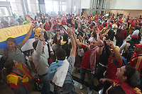 Spanish fans sing and cheer after flying into Johannesburg International Airport before the 2010 FIFA World Cup Final between Spain and Holland happened at Soccer City in Soweto, South Africa on Sunday, July 11, 2010.  Spain defeated Netherlands 1-0.