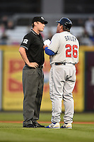 Tennessee Smokies manager Buddy Bailey (26) argues a call with umpire Alex Ziegler during a game against the Birmingham Barons on April 22, 2014 at Regions Field in Birmingham, Alabama.  Birmingham defeated Tennessee 14-3.  (Mike Janes/Four Seam Images)