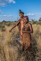 Africa, Botswana, Khwai, The Lodge, Feline Fields, edge of the Kalahari desert. Kalahari bush people, Ju'hoansi tribe. Hunter-gatherer !Kung people, part of San tribe. Father and daughter.