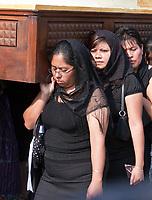 Antigua, Guatemala. Women Carrying a  Float (Anda) in a Good Friday Religious Procession, Holy Week, La Semana Santa.