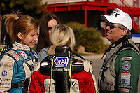 "Jan 20, 2007; Las Vegas, NV, USA; NHRA Funny Car driver John Force talks with his daughters Courtney Force and Brittany Force during preseason testing at ""The Strip"" at Las Vegas Motor Speedway in Las Vegas, NV. Mandatory Credit: Mark J. Rebilas"