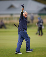3rd October 2021; The Old Course, St Andrews Links, Fife, Scotland; European Tour, Alfred Dunhill Links Championship, Fourth round; American investment banker and philanthropist Jimmy Dunne, amateur partner of Danny Willett,  raises his hat to the crowd after holing a great putt on the 3rd green during the final round of the Alfred Dunhill Links Championship on the Old Course, St Andrews