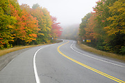 Autumn foliage along Route 26 in Dixville Notch Notch State Park in Dixville, New Hampshire USA during the autumn months
