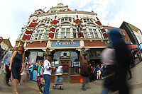 People passing by the Boleyn pub  before  the Barclays Premier League match between West Ham United and Swansea City  played at Boleyn Ground , London on 7th May 2016