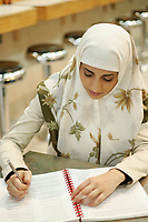 2005, Montreal Qc) CANADA<br /> Model Released photo<br /> Young Muslim woman from Irak wear the hidjab in a Montreal, CANADA coffee shop<br /> Photo : (c) 2005 Pierre Roussel